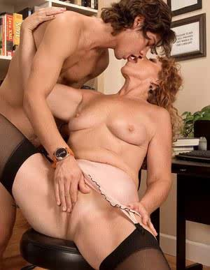 Horny mature librarian ball sucking and riding young student in the library