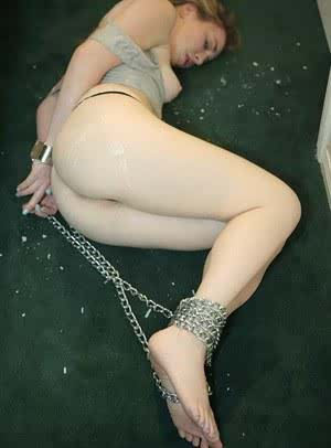 Young slave Mattie Borders bound with chains endures forced deepthroat