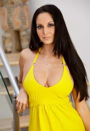 Brunette MILF Ava Addams poses enticingly in yellow dress  sexy footwear