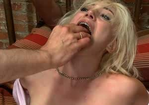 Kinky tied up blonde Moretta enjoys a gangbang with some horny men