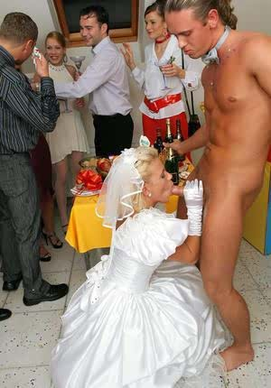 New bride dressed in her wedding dress plays water sport games at reception