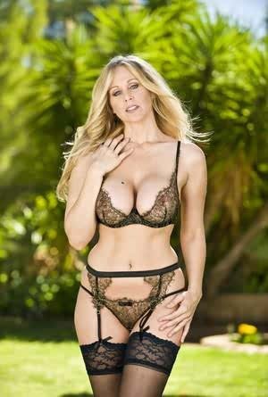 Blonde business lady Julia Ann strips to her stockings and nylons after work
