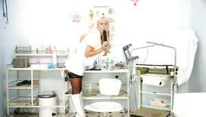 Blonde mature nurse stuffing her cunt with a dildo and a speculum