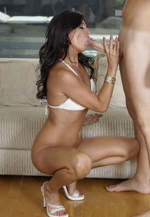 MILF Soraya Rico seduces her man in skimpy white bikini and high heeled shoes